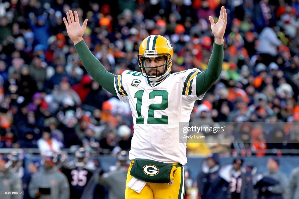 Quarterback <a gi-track='captionPersonalityLinkClicked' href=/galleries/search?phrase=Aaron+Rodgers+-+Football+americano+-+Quarterback&family=editorial&specificpeople=215257 ng-click='$event.stopPropagation()'>Aaron Rodgers</a> #12 of the Green Bay Packers reacts after James Starks #44 of the Packers scores on a four-yard touchdown run in the second quarter against the Chicago Bears in the NFC Championship Game at Soldier Field on January 23, 2011 in Chicago, Illinois.