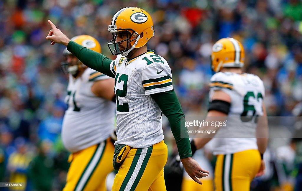 Quarterback <a gi-track='captionPersonalityLinkClicked' href=/galleries/search?phrase=Aaron+Rodgers+-+American+Football+Quarterback&family=editorial&specificpeople=215257 ng-click='$event.stopPropagation()'>Aaron Rodgers</a> #12 of the Green Bay Packers reacts in the second quarter against the Seattle Seahawks during the 2015 NFC Championship game at CenturyLink Field on January 18, 2015 in Seattle, Washington.