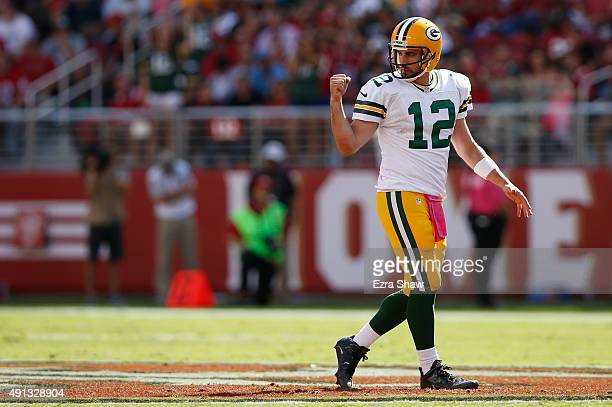 Quarterback Aaron Rodgers of the Green Bay Packers reacts to a first down against the San Francisco 49ers during their NFL game at Levi's Stadium on...