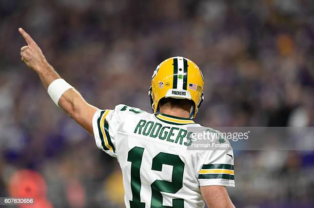 Quarterback Aaron Rodgers of the Green Bay Packers signals for a first down during their game against the Minnesota Vikings on September 18 2016 at...