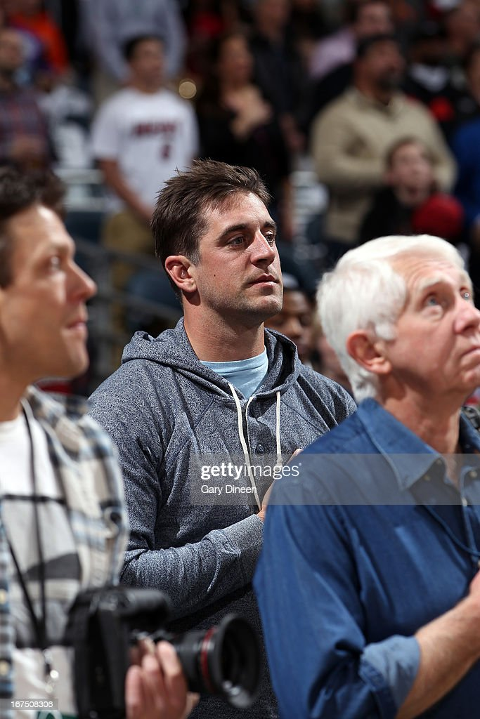 NFL Quarterback Aaron Rodgers of the Green Bay Packers stands during the National Anthem prior to Game Three of the Eastern Conference Quarterfinals between the Miami Heat and the Milwaukee Bucks during the 2013 NBA Playoffs on April 25, 2013 at the BMO Harris Bradley Center in Milwaukee, Wisconsin.