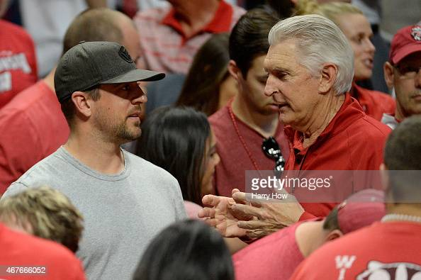 NFL quarterback Aaron Rodgers of the Green Bay Packers talks with golfer Andy North during the West Regional Semifinal of the 2015 NCAA Men's...