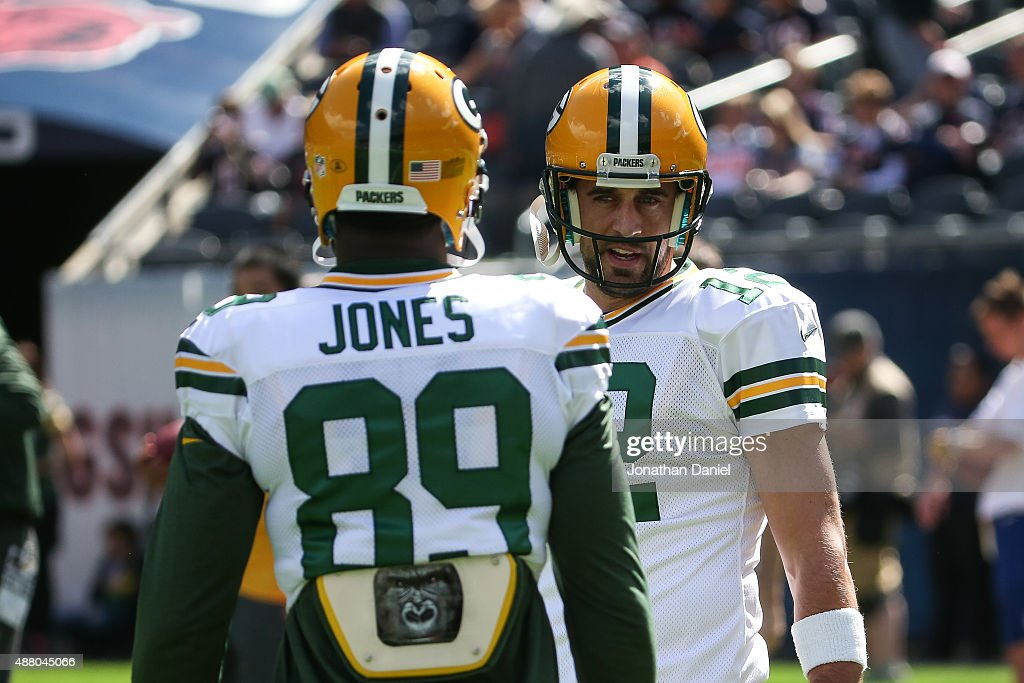 Quarterback Aaron Rodgers #12 of the Green Bay Packers talks with James Jones #89 prior to the game against the Chicago Bears at Soldier Field on September 13, 2015 in Chicago, Illinois.