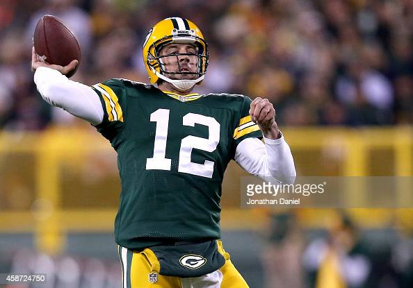 Quarterback Aaron Rodgers of the Green Bay Packers throws 73 yards for a touchdown against the Chicago Bears in the second quarter at Lambeau Field...
