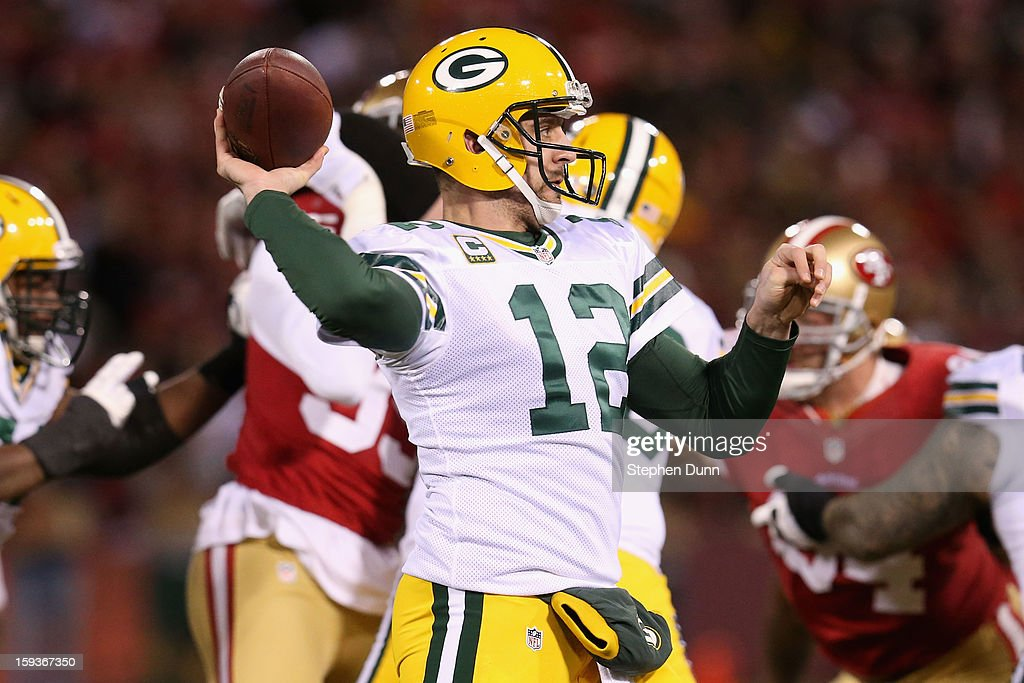 Quarterback <a gi-track='captionPersonalityLinkClicked' href=/galleries/search?phrase=Aaron+Rodgers+-+Joueur+de+football+am%C3%A9ricain+-+Quarterback&family=editorial&specificpeople=215257 ng-click='$event.stopPropagation()'>Aaron Rodgers</a> #12 of the Green Bay Packers throws the ball against the San Francisco 49ers in the first quarter during the NFC Divisional Playoff Game at Candlestick Park on January 12, 2013 in San Francisco, California.