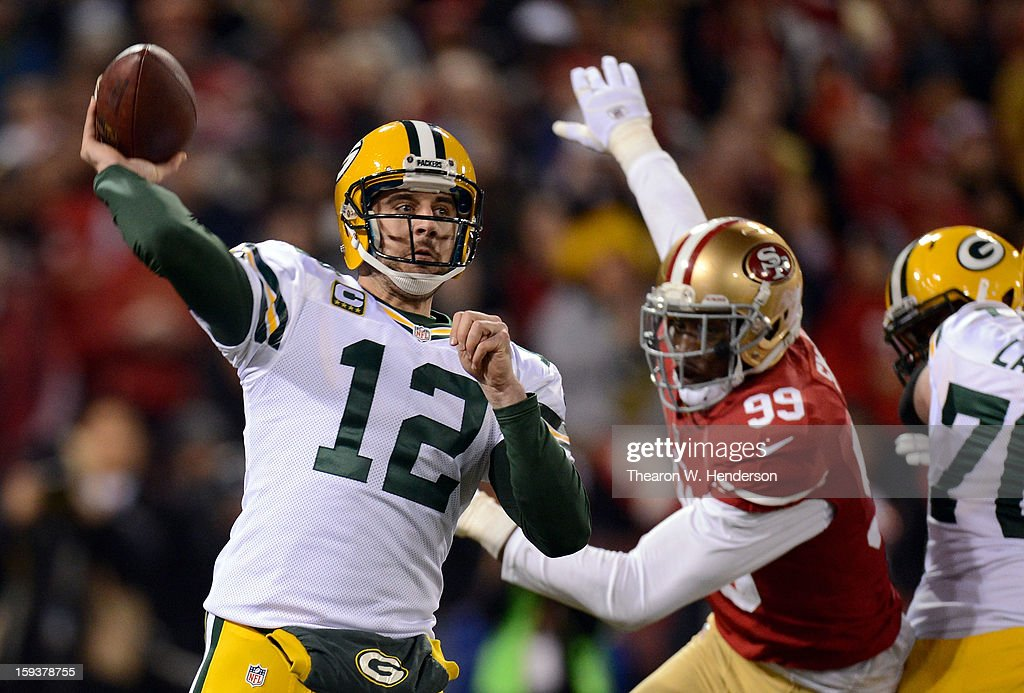 Quarterback Aaron Rodgers #12 of the Green Bay Packers throws the ball against the San Francisco 49ers during the NFC Divisional Playoff Game at Candlestick Park on January 12, 2013 in San Francisco, California.