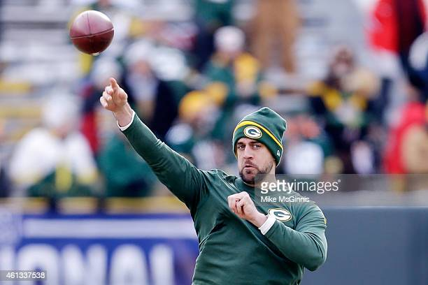 Quarterback Aaron Rodgers of the Green Bay Packers warms up prior to the 2015 NFC Divisional Playoff game against the Dallas Cowboys at Lambeau Field...