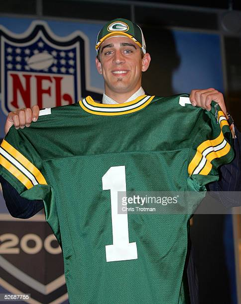 Quarterback Aaron Rodgers poses with his jersey after being drafted 24th overall by the Green Bay Packers during the 70th NFL Draft on April 23 2005...
