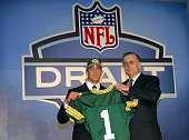 Quarterback Aaron Rodgers poses with NFL Commissioner Paul Tagliabue after Rodgers was drafted 24th overall by the Green Bay Packers during the 70th...