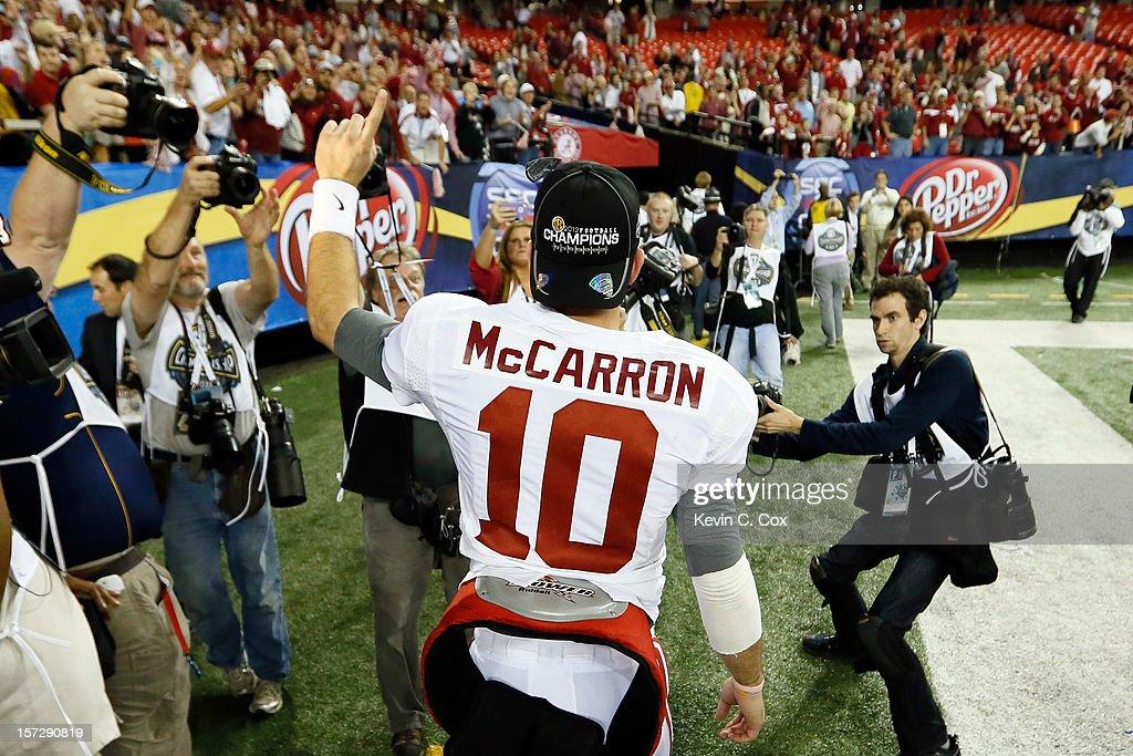 Quarterback AJ McCarron #10 of the Alabama Crimson Tide celebrates following Alabama's 32-28 win over the Georgia Bulldogs to win the SEC Championship Game at the Georgia Dome on December 1, 2012 in Atlanta, Georgia.