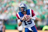 Quarterback Alex Brink of the Montreal Alouettes rolls out in a game between the Montreal Alouettes and Saskatchewan Roughriders in week 8 of the...