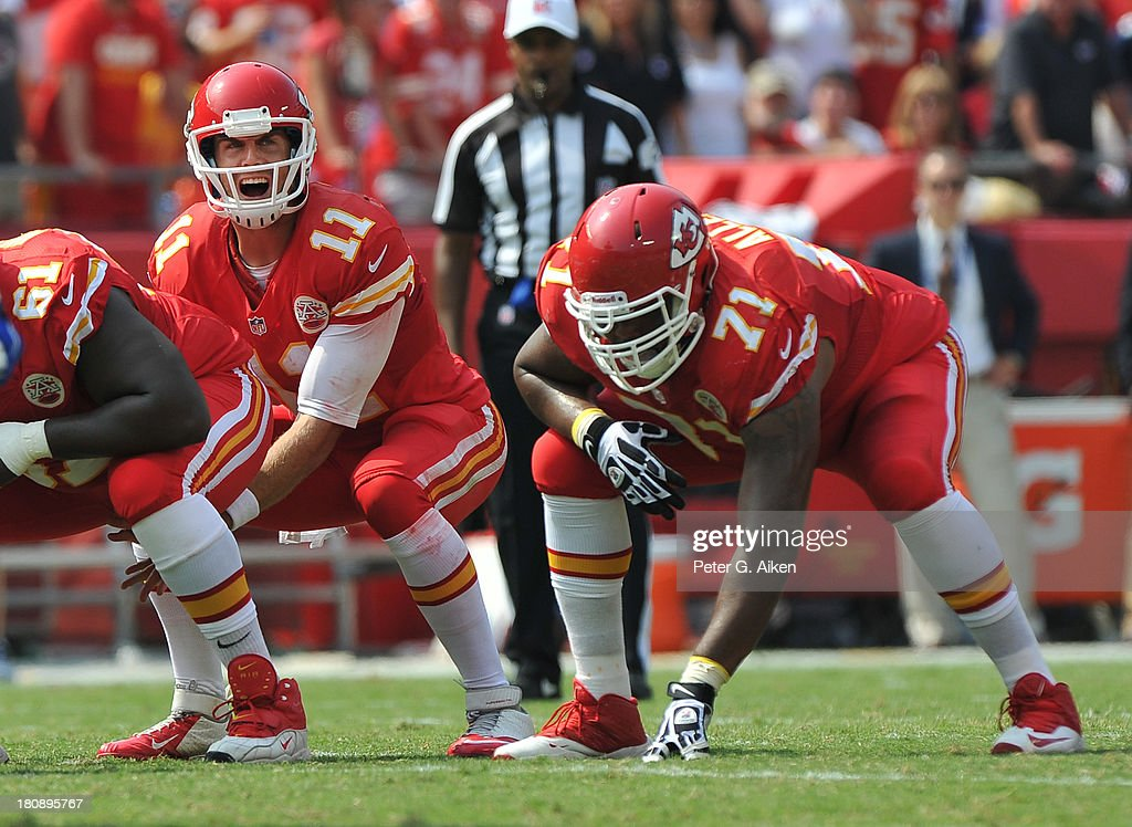 Quarterback Alex Smith #11 of the Kansas City Chiefs calls out a play at the line, as offensive guard Jeff Allen #71 gets set against the Dallas Cowboys during the second half on September 15, 2013 at Arrowhead Stadium in Kansas City, Missouri.