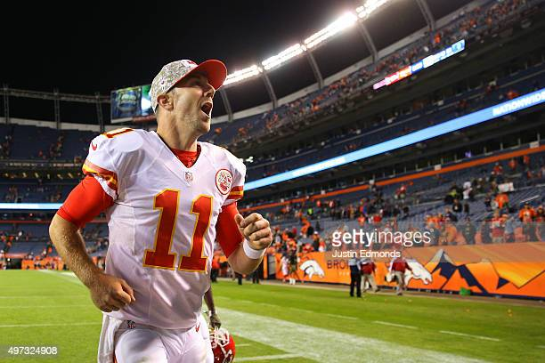 Quarterback Alex Smith of the Kansas City Chiefs celebrates as he runs off the field following the Chiefs win against the Denver Broncos at Sports...