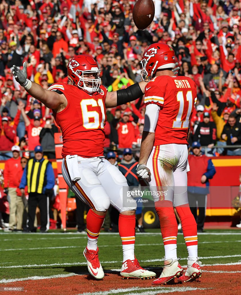 Quarterback Alex Smith #11 of the Kansas City Chiefs celebrates in the end zone with teammate Mitch Morse #61 after scoring the games first touchdown against the Tampa Bay Buccaneers at Arrowhead Stadium during the second quarter of the game on November 20, 2016 in Kansas City, Missouri.