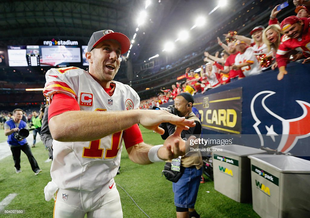 Quarterback Alex Smith #11 of the Kansas City Chiefs celebrates their 30-0 win over the Houston Texans during the AFC Wild Card Playoff game at NRG Stadium on January 9, 2016 in Houston, Texas.