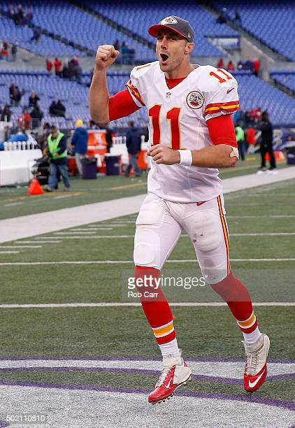 Quarterback Alex Smith of the Kansas City Chiefs celebrates while running off the field following the Chiefs 3414 win over the Baltimore Ravens at MT...