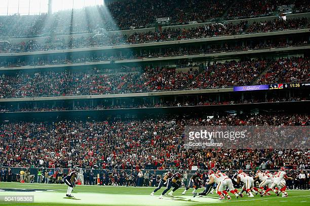 Quarterback Alex Smith of the Kansas City Chiefs drops back to pass against the Houston Texans during the first quarter of the AFC Wild Card Playoff...