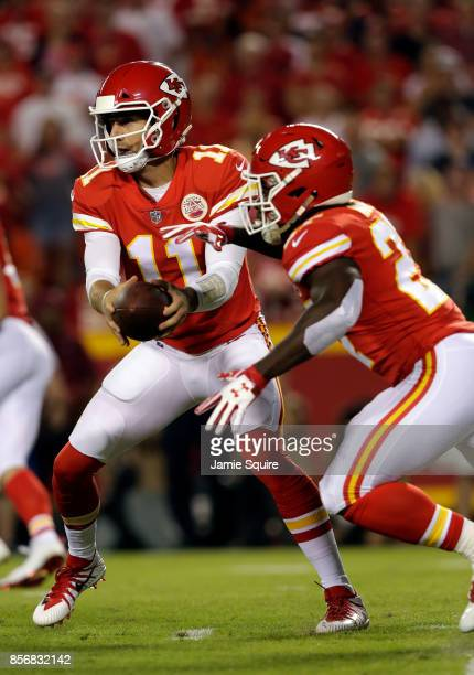 Quarterback Alex Smith of the Kansas City Chiefs hands off to running back Kareem Hunt during the game against the Washington Redskins at Arrowhead...