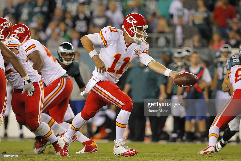 Quarterback Alex Smith #11 of the Kansas City Chiefs hands-off during a game against the Philadelphia Eagles on September 19, 2013 at Lincoln Financial Field in Philadelphia, Pennsylvania. The Chiefs won 26-16.