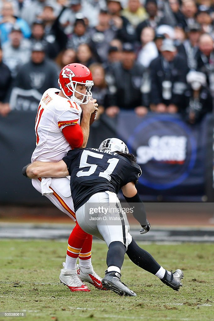 Quarterback <a gi-track='captionPersonalityLinkClicked' href=/galleries/search?phrase=Alex+Smith+-+American+Football+Quarterback&family=editorial&specificpeople=4584854 ng-click='$event.stopPropagation()'>Alex Smith</a> #11 of the Kansas City Chiefs is sacked by inside linebacker <a gi-track='captionPersonalityLinkClicked' href=/galleries/search?phrase=Ben+Heeney&family=editorial&specificpeople=9689082 ng-click='$event.stopPropagation()'>Ben Heeney</a> #51 of the Oakland Raiders of the Oakland Raiders during the second quarter at O.co Coliseum on December 6, 2015 in Oakland, California. The Kansas City Chiefs defeated the Oakland Raiders 34-20. Photo by Jason O. Watson/Getty Images)