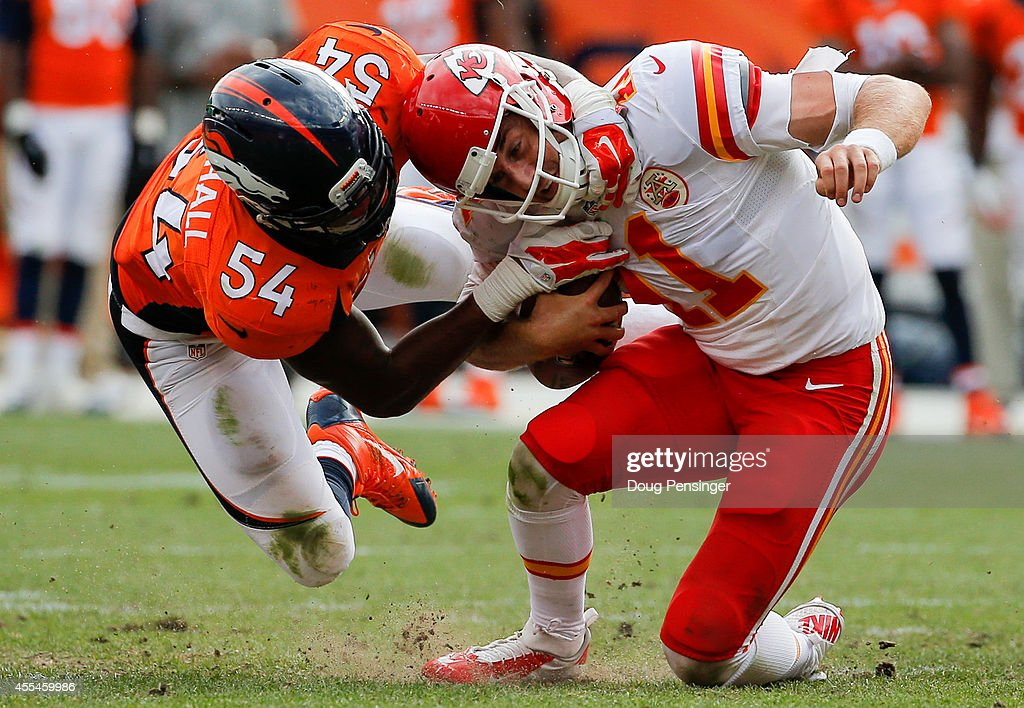 Quarterback Alex Smith #11 of the Kansas City Chiefs is sacked by outside linebacker Brandon Marshall #54 of the Denver Broncos during a game at Sports Authority Field at Mile High on September 14, 2014 in Denver, Colorado.