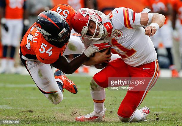 Quarterback Alex Smith of the Kansas City Chiefs is sacked by outside linebacker Brandon Marshall of the Denver Broncos during a game at Sports...