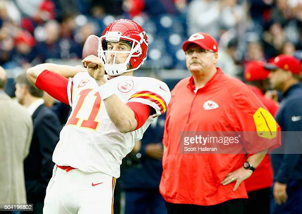 Quarterback Alex Smith of the Kansas City Chiefs looks to pass as head coach Andy Reid looks on before the AFC Wild Card Playoff game against the...