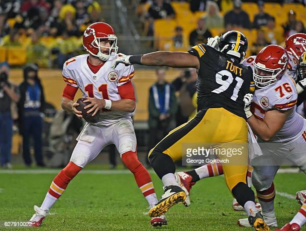 Quarterback Alex Smith of the Kansas City Chiefs looks to pass as offensive lineman Laurent DuvernayTardif blocks defensive lineman Stephon Tuitt of...