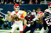 Quarterback Alex Smith of the Kansas City Chiefs looks to pass against the Houston Texans during the AFC Wild Card Playoff game at NRG Stadium on...