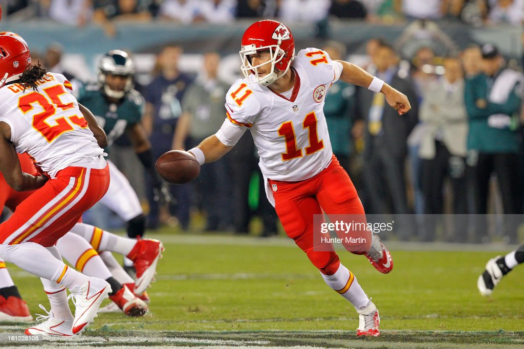 Quarterback Alex Smith #11 of the Kansas City Chiefs misses a hand-off during a game against the Philadelphia Eagles on September 19, 2013 at Lincoln Financial Field in Philadelphia, Pennsylvania. The Chiefs won 26-16.