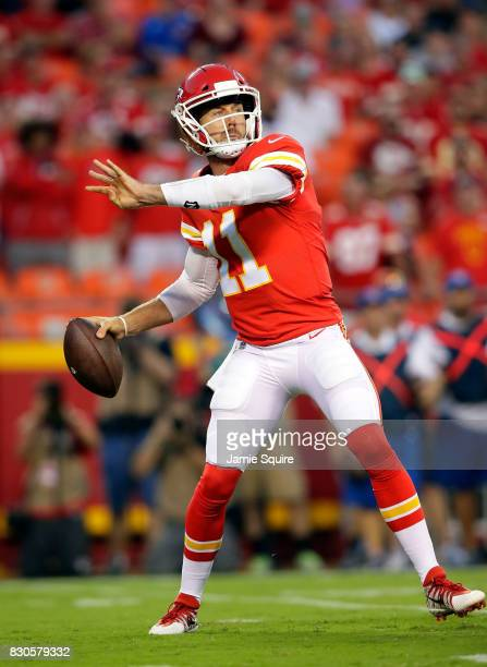 Quarterback Alex Smith of the Kansas City Chiefs passes during the preseason game against the San Francisco 49ers at Arrowhead Stadium on August 11...