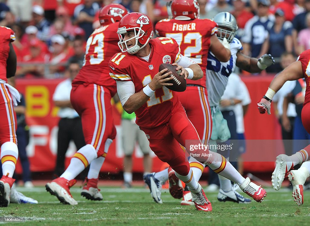 Quarterback Alex Smith #11 of the Kansas City Chiefs rolls to the outside against the Dallas Cowboys during the second half on September 15, 2013 at Arrowhead Stadium in Kansas City, Missouri. Kansas City defeated Dallas 17-16.