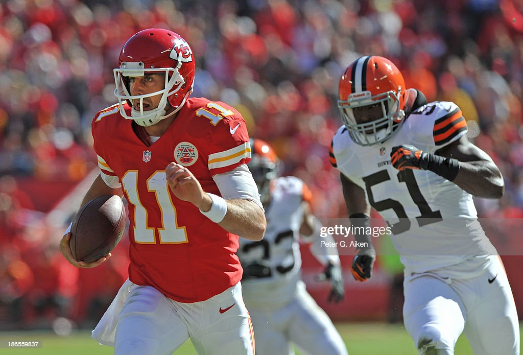 Quarterback Alex Smith of the Kansas City Chiefs rushes down field against linebacker Barkevious Mingo of the Cleveland Browns during the first half...
