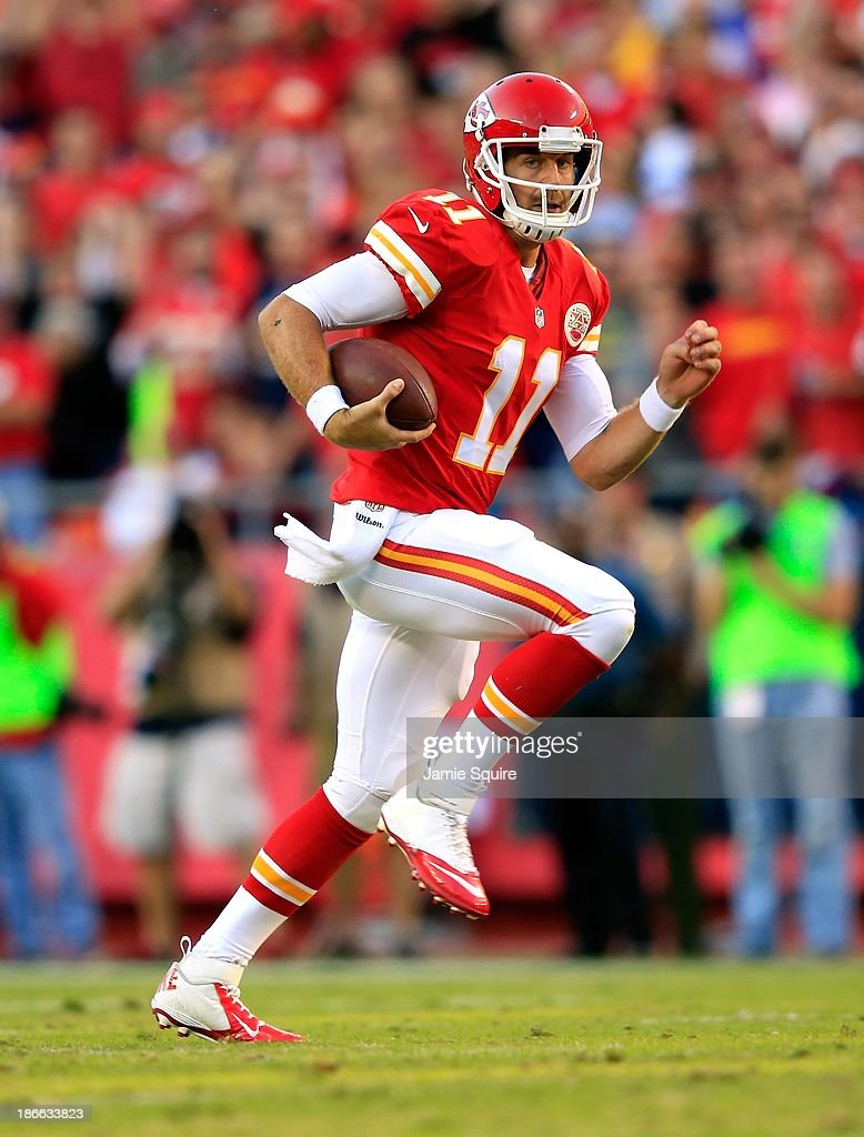 Quarterback Alex Smith #11 of the Kansas City Chiefs scrambles during the game against the Houston Texans at Arrowhead Stadium on October 20, 2013 in Kansas City, Missouri.