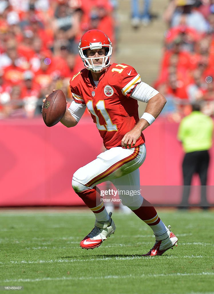 Quarterback Alex Smith #11 of the Kansas City Chiefs scrambles to the outside against the New York Giants during the first half on September 29, 2013 at Arrowhead Stadium in Kansas City, Missouri. Kansas City defeated New York 31-7.