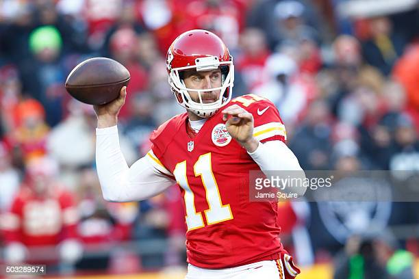 Quarterback Alex Smith of the Kansas City Chiefs throws a pass at Arrowhead Stadium during the first quarter of the game against the Oakland Raiders...