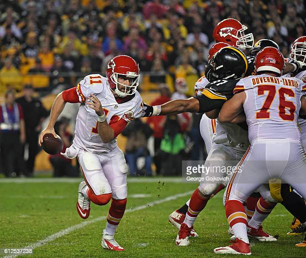 Quarterback Alex Smith of the Kansas City Chiefs tries to avoid the reach of defensive lineman Cameron Heyward of the Pittsburgh Steelers as...
