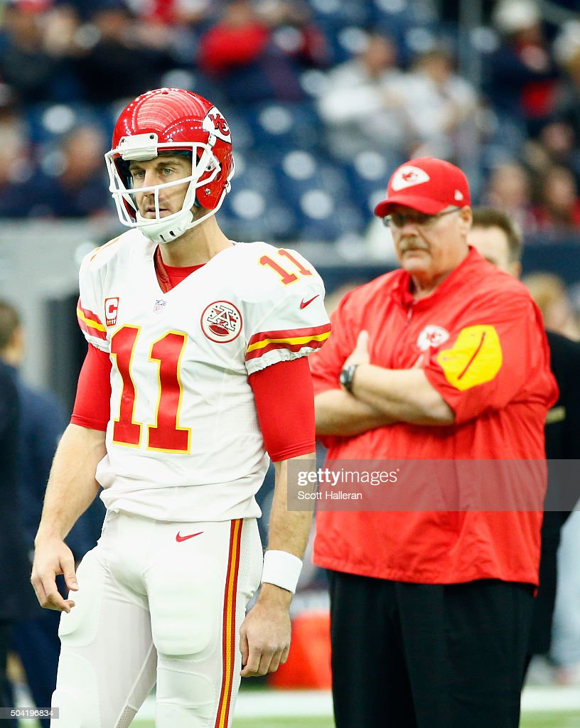 Quarterback Alex Smith of the Kansas City Chiefs warmsup as head coach Andy Reid looks on before the AFC Wild Card Playoff game against the Houston...