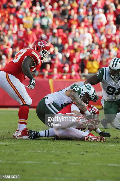 Quarterback Alex Smith of the Kasas City Chiefs is sacked by Linebacker Jason Babin of the New York Jets at Arrowhead Stadium on November 2 2014 in...