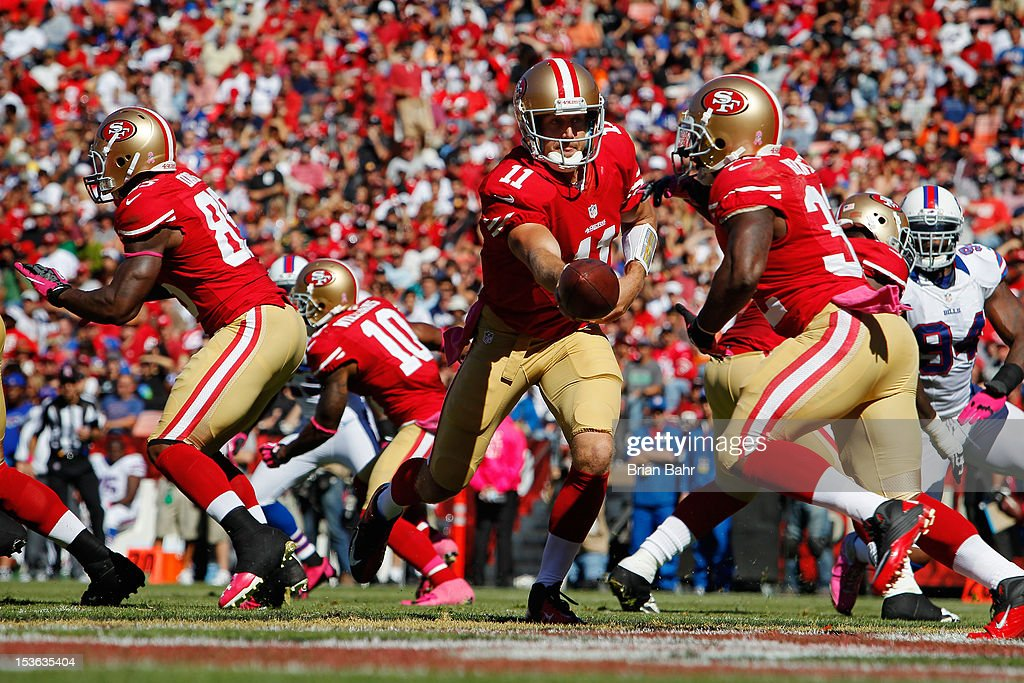 Quarterback Alex Smith #11 of the San Francisco 49ers drops back to hand the ball off to <a gi-track='captionPersonalityLinkClicked' href=/galleries/search?phrase=Kendall+Hunter&family=editorial&specificpeople=4542833 ng-click='$event.stopPropagation()'>Kendall Hunter</a> #32 in their own endzone against the Buffalo Bills in the third quarter on October 7, 2012 at Candlestick Park in San Francisco, California. The 49ers won 45-3.