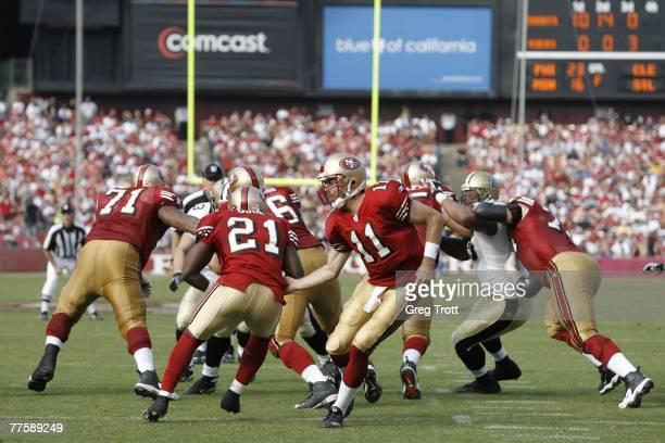 Quarterback Alex Smith of the San Francisco 49ers hands off the ball to Frank Gore during the game against the New Orleans Saints on October 28 2007...