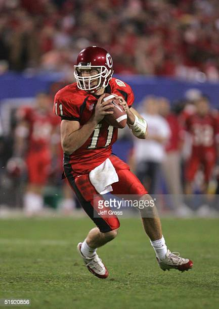 Quarterback Alex Smith of Utah looks to pass against Pittsburgh in the second quarter of the Tostito's Fiesta Bowl at the Sun Devil Stadium on...