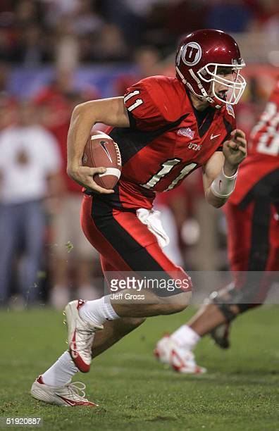 Quarterback Alex Smith of Utah runs the ball against Pittsburgh in the Tostito's Fiesta Bowl at the Sun Devil Stadium on January 1 2005 in Tempe...