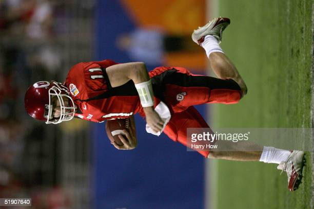 Quarterback Alex Smith of Utah runs with the ball in the first quarter against Pittsburgh in the Tostito's Fiesta Bowl at the Sun Devil Stadium on...