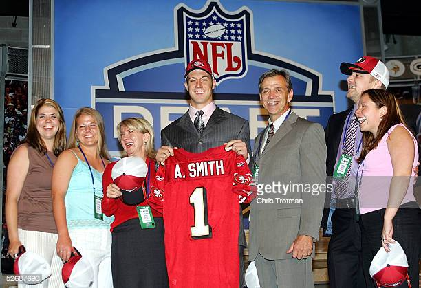 Quarterback Alex Smith who was drafted first overall by the San Francisco 49ers poses with his family during the 70th NFL Draft on April 23 2005 at...