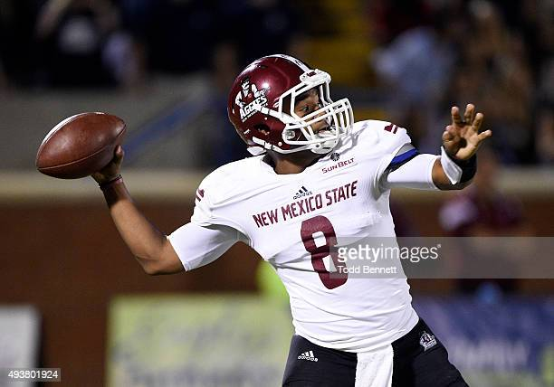 Quarterback Andrew Allen of the New Mexico State Aggies attempts a pass against the Georgia Southern Eagles during the second quarter on October 17...