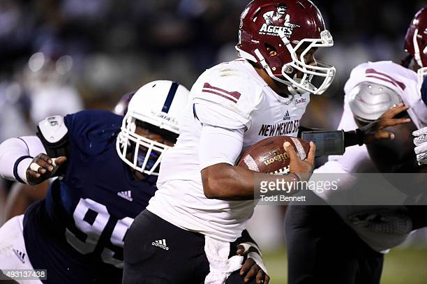 Quarterback Andrew Allen of the New Mexico State Aggies eludes defenders from the Georgia Southern Eagles during the second quarter on October 17...