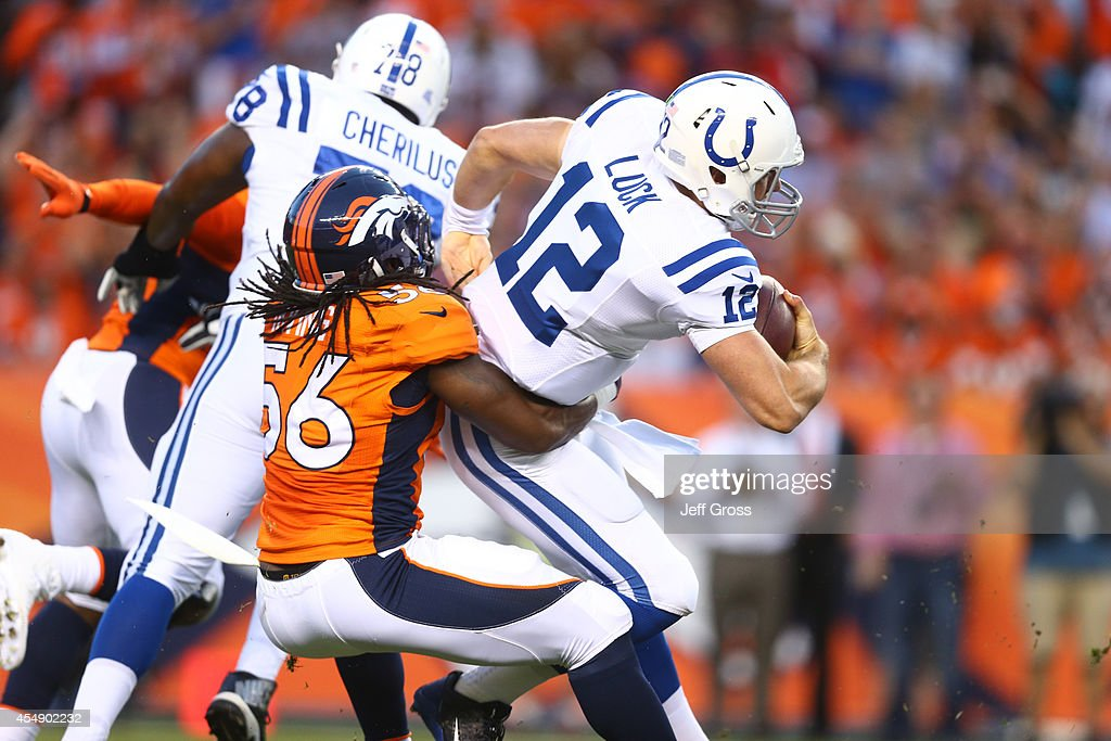 Quarterback <a gi-track='captionPersonalityLinkClicked' href=/galleries/search?phrase=Andrew+Luck&family=editorial&specificpeople=6258221 ng-click='$event.stopPropagation()'>Andrew Luck</a> #12 of the Indianapolis Colts is sacked by outside linebacker <a gi-track='captionPersonalityLinkClicked' href=/galleries/search?phrase=Nate+Irving&family=editorial&specificpeople=4753462 ng-click='$event.stopPropagation()'>Nate Irving</a> #56 of the Denver Broncos during a game at Sports Authority Field at Mile High on September 7, 2014 in Denver, Colorado.