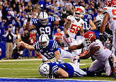 Quarterback Andrew Luck of the Indianapolis Colts scores a touchdown in the fourth quarter after recovering a fumble against the Kansas City Chiefs...