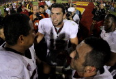 Quarterback Andrew Luck of the Stanford Cardinal celebrates with teammates after the game with the USC Trojans at the Los Angeles Memorial Coliseum...